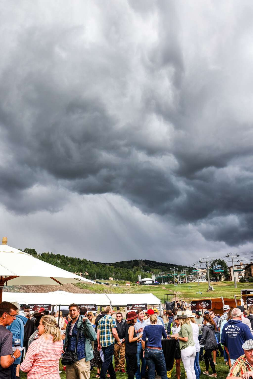 A storm is approaching during the Heritage Fire on Saturday July 31, 2021 at Snowmass Base Village.  Photo by Austin Colbert / The Aspen Times.