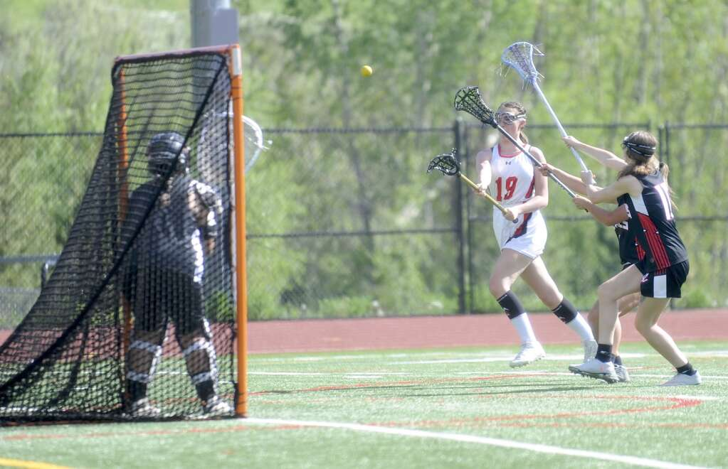 Steamboat Springs girls lacrosse player Bella Brinkman scores during a game against Eagle Valley at Gardner Field on Thursday night. (Shelby Reardon)