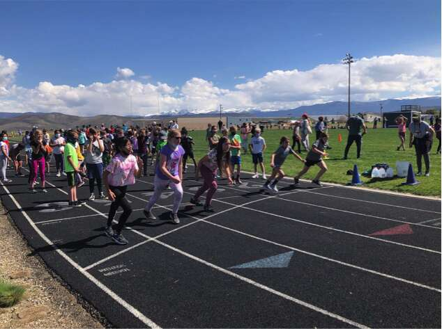 Elementary students line up during the start of a race for East Grand's district-wide elementary field day.