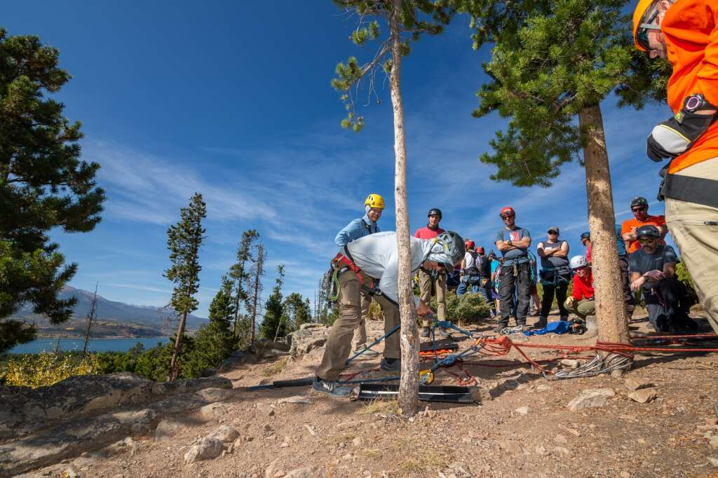 Brian Taylor, center, demonstrates good climbing safety practices during a search and rescue training course on Friday, September 24, near Windy Point Campground.  |  Liz Copan / For the Daily News Summit