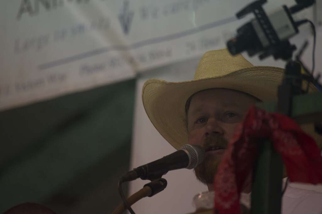 The auctioneer speaks to the crowd at the Moffat County Fair livestock auction Saturday evening. | Cuyler Meade / Craig Press