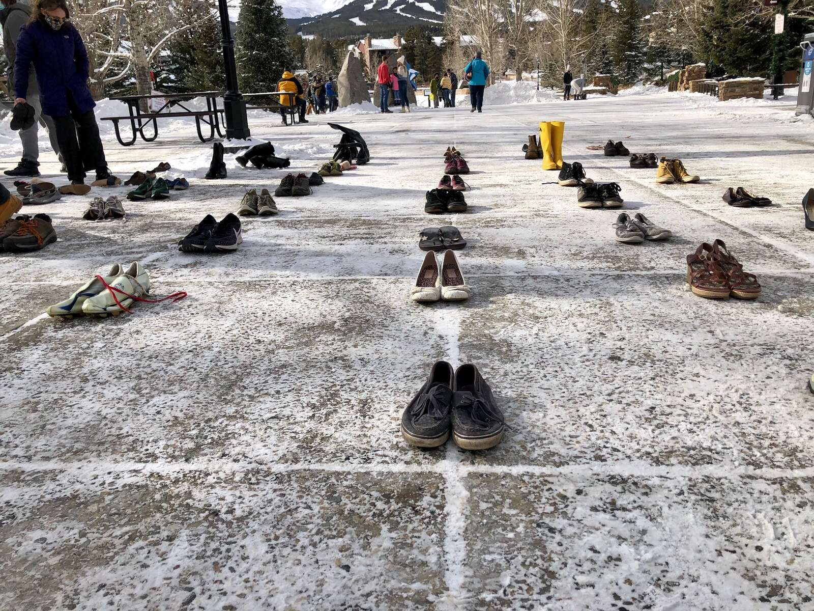 Pairs of shoes represent climate change-related deaths in Colorado during a demonstration Monday, Dec. 14. | Photo by Taylor Sienkiewicz / tsienkiewicz@summitdaily.com
