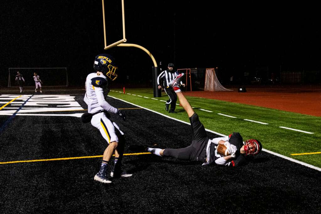 Aspen High School scores their third touchdown of the game against Rifle High School in Aspen on Friday, Oct. 1, 2021. (Kelsey Brunner/The Aspen Times)