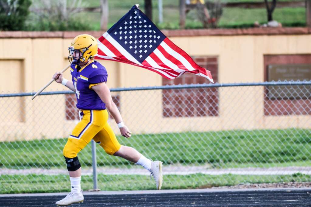Basalt High School's Cole Dombrowski carries the American Flag onto the field prior to their game with Battle Mountain on Thursday, Sept. 2, 2021, on the BHS field. | Photo by Austin Colbert/The Aspen Times