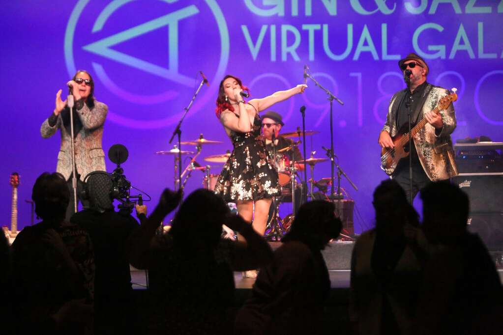 A live interactive dance party courtesy the band Pop Rocks, is streamed from the stage at the Center for the Arts' Virtual Gala Saturday Sept. 21 where $75,000 worth of items were auctioned off to help purchase equipment for the center. Winners of the night's final prize won attendance to the live streamed performance for $2,500.   Photo: Elias Funez