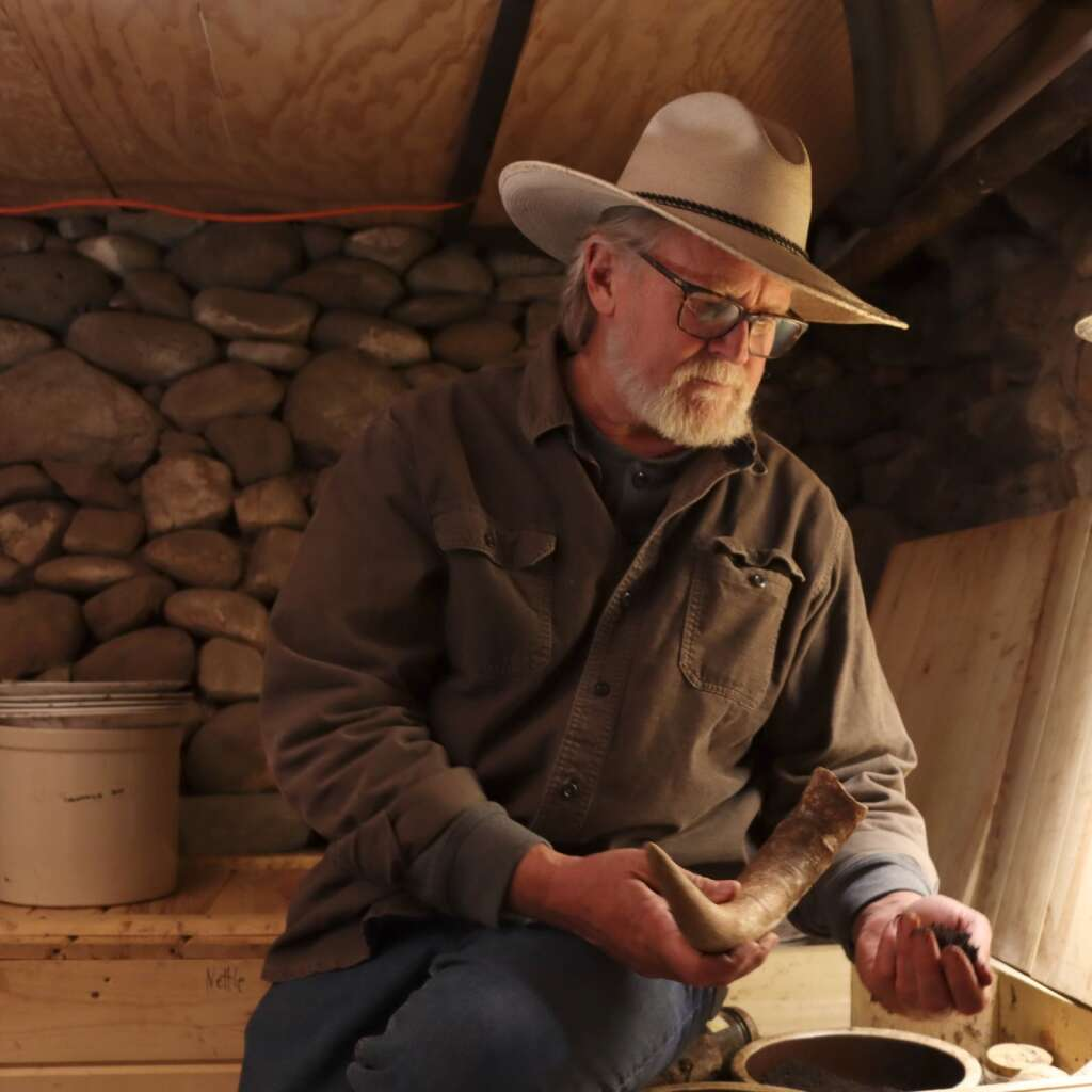 Brook LeVan in the root cellar at Sustainable Settings. Photo Tyler Bopp
