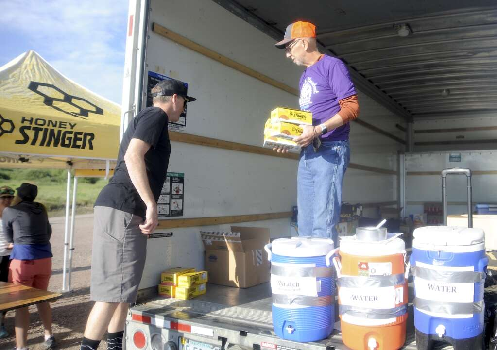 Earl Weintraub makes sure snack tables are well stocked, grabbing unopened boxes out of a Uhaul at the Stagecoach aid station as part of the Tour de Steamboat Springs on Saturday. (Photo by Shelby Reardon)