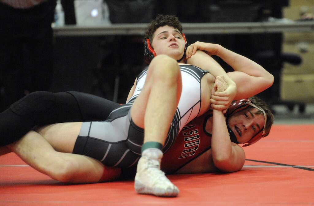 Steamboat Springs senior Cole Moon tries to free himself from the grip of Strasburg's Blake Coombs in a consolation match at the CHSAA State Wrestling Championships at the Southwest Event Center in Pueblo on Friday.