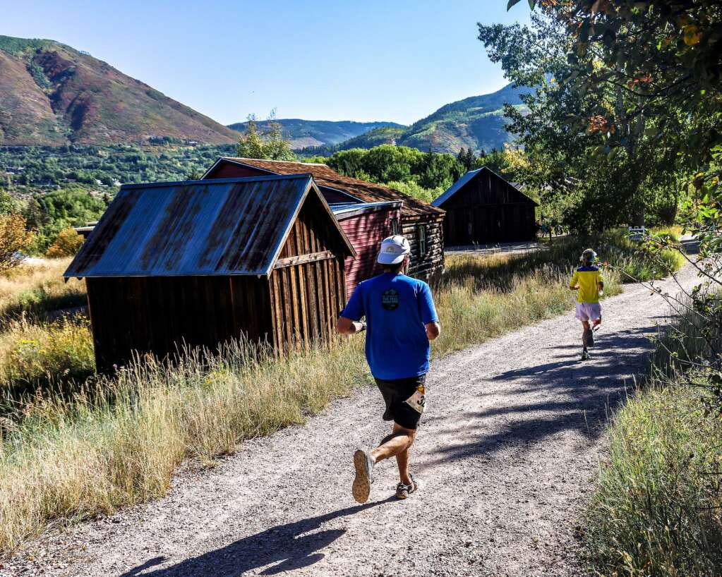 Runners pass by the Holden/Marolt Mining & Ranching Museum during the Golden Leaf half marathon on Saturday, Sept. 18, 2021, in Aspen. Photo by Austin Colbert/The Aspen Times.