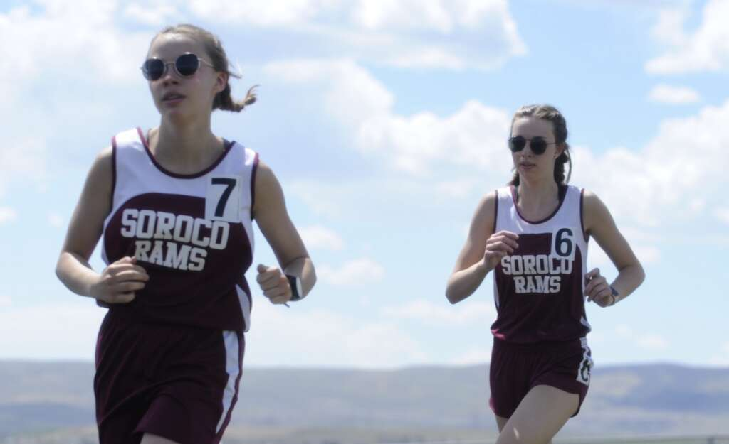 Rose Karrow and Eden Mayer run in the 1600 at the Clint Wells Invitational in Craig on Friday. (Photo by Shelby Reardon)