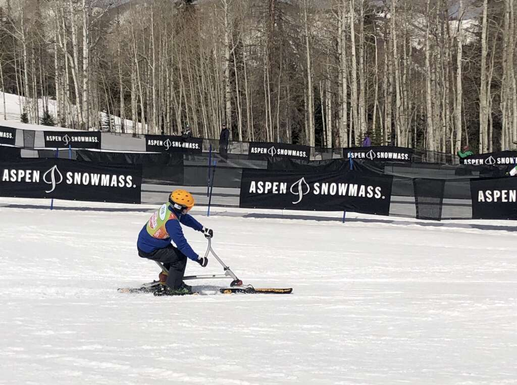 Snowbiker Mike Sparkman slides to a stop in the finish area after competing in the slalom warm-up race at NASTAR national championships in Snowmass on April 5, 2021. | Kaya Williams/The Aspen Times