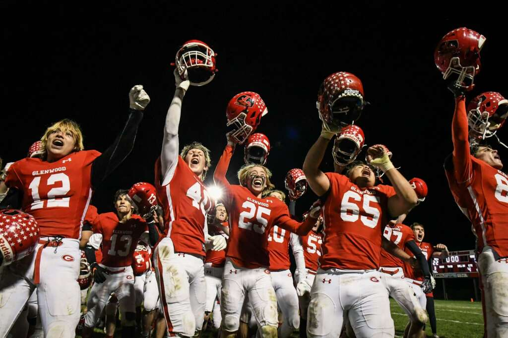 The Glenwood Springs Demons react after defeating the Rifle Bears during Friday night's rivalry game at Stubler Memorial Field. |Chelsea Self / Post Independent