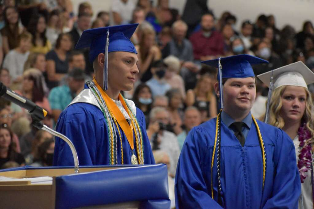 Senior Caleb Frink waits to cross the stage and receive his diploma Saturday. (Joshua Carney / Craig Press)