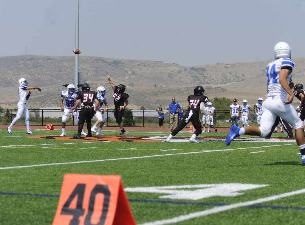 Mancos quarterback Ayden Mathews passes to a teammate during the Hayden football  home opener against Mancos on Saturday afternoon at Hayden Valley School. (Photo by Shelby Reardon)