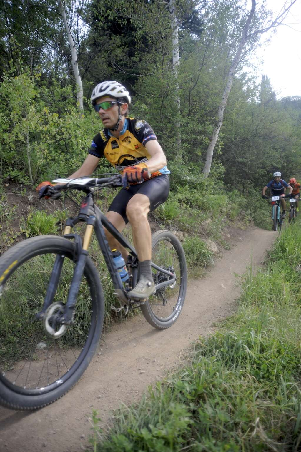 The men's 50+ expert division speeds along the singletrack at the Town Challenge Emerald Endurance race on Wednesday evening. (Photo by Shelby Reardon)