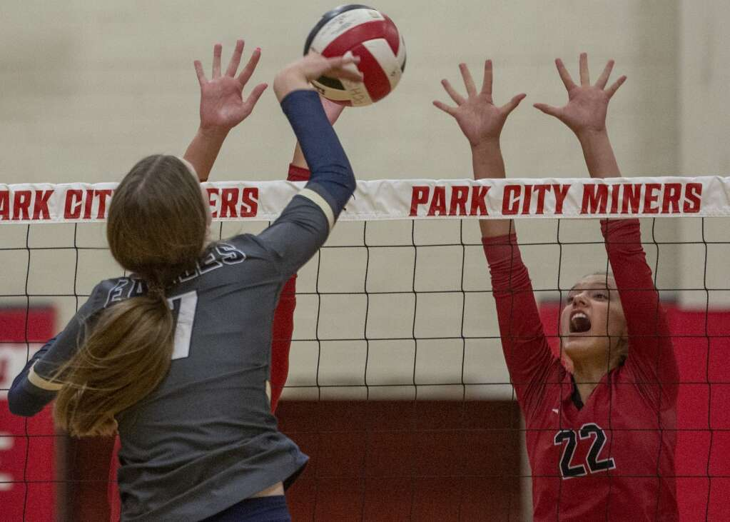 Park City High School sophomore Bella Ciraco (22) jumps up to the net to block a spike from Skyline High School's Eve Wilson (7) during their matchup Tuesday evening, Sept. 21, 2021. The Miners were swept 3-0 by the Eagles. (Tanzi Propst/Park Record)