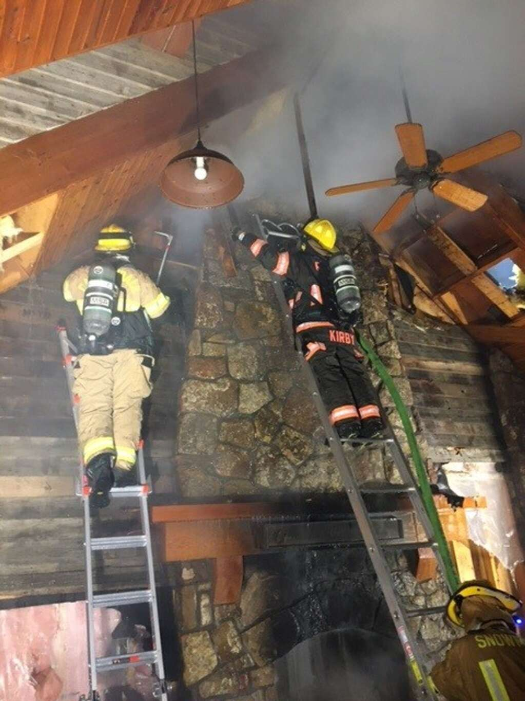 Firefighters seek flames at a pavilion at a residence on Snowmass Creek Road. | Roaring Fork Fire Rescue/courtesy photo