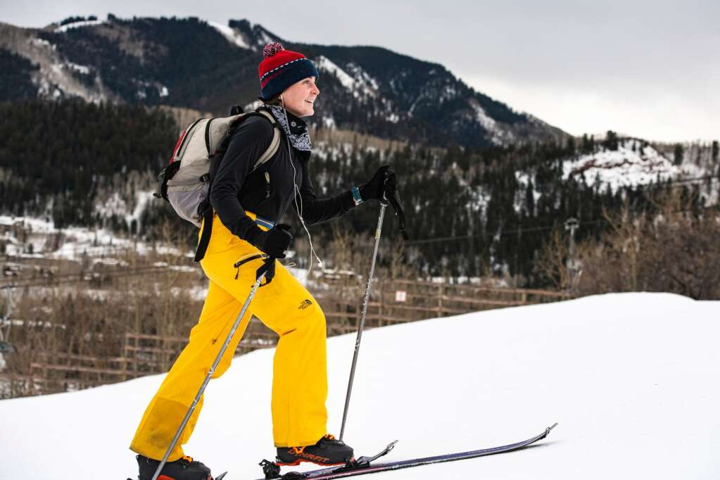 Rosemary O'Hagan skins up Tiehack in the later afternoon in Aspen on Friday, Jan. 22, 2021. O'Hagan moved here for the winter season and works remotely. She explained that her husband is a deployed Marine and she moved from California. (Kelsey Brunner/The Aspen Times)