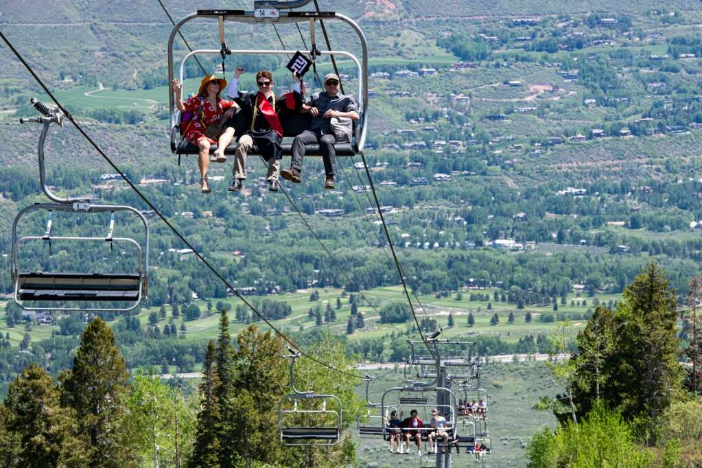 Aspen High School graduates ride the Tiehack Lift to the top of Buttermilk after the commencement ceremony on Saturday, June 5, 2021. (Kelsey Brunner/The Aspen Times)