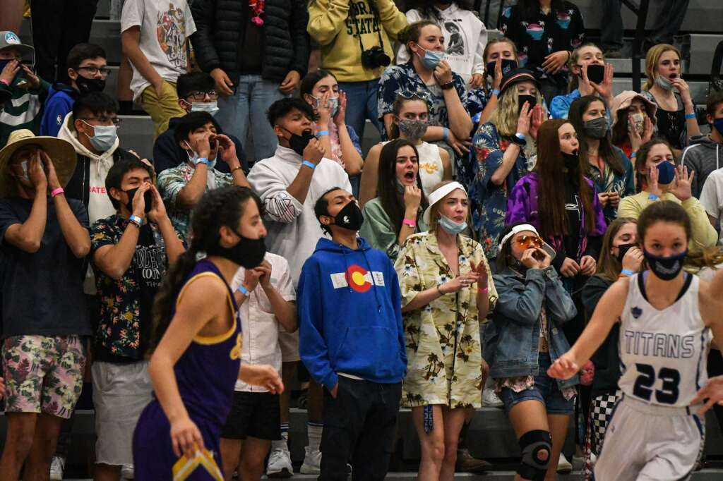 The Coal Ridge Titan student section cheers on the players during Tuesday night's playoff game against the Ellicott Thunderhawks. |Chelsea Self / Post Independent