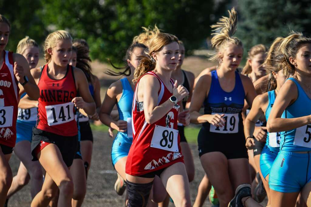 Girls cross country runners take off from the starting line during Friday morning Coal Ridge cross county meet at VIX Park in New Castle. |Chelsea Self / Post Independent
