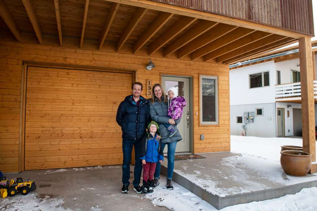 Jeremy Duncan, left, stands with his son Arlo, 4, wife Lyssa, and daughter Willa, 2, outside of their home in Basalt Vista on Friday, Feb. 5, 2021. (Kelsey Brunner/The Aspen Times)