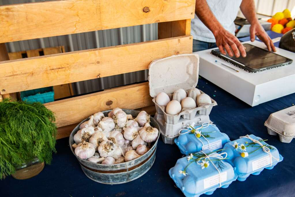 Chicken and duck eggs from local farms alongside fresh produce are on display at the farm stand at Two Roots Farm in Emma on Friday, Sept. 17, 2021. (Kelsey Brunner/The Aspen Times)