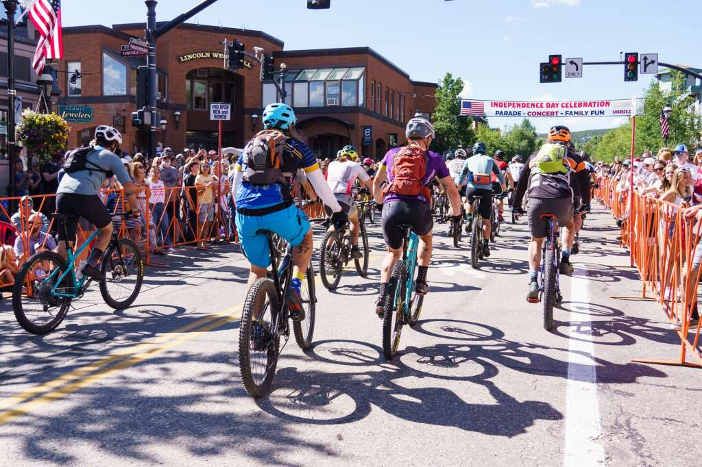 Racers depart the start line at the heart of downtown Breckenridge for the Firecracker 50 mountain bike race on July 4, 2021. | Photo by John Hanson