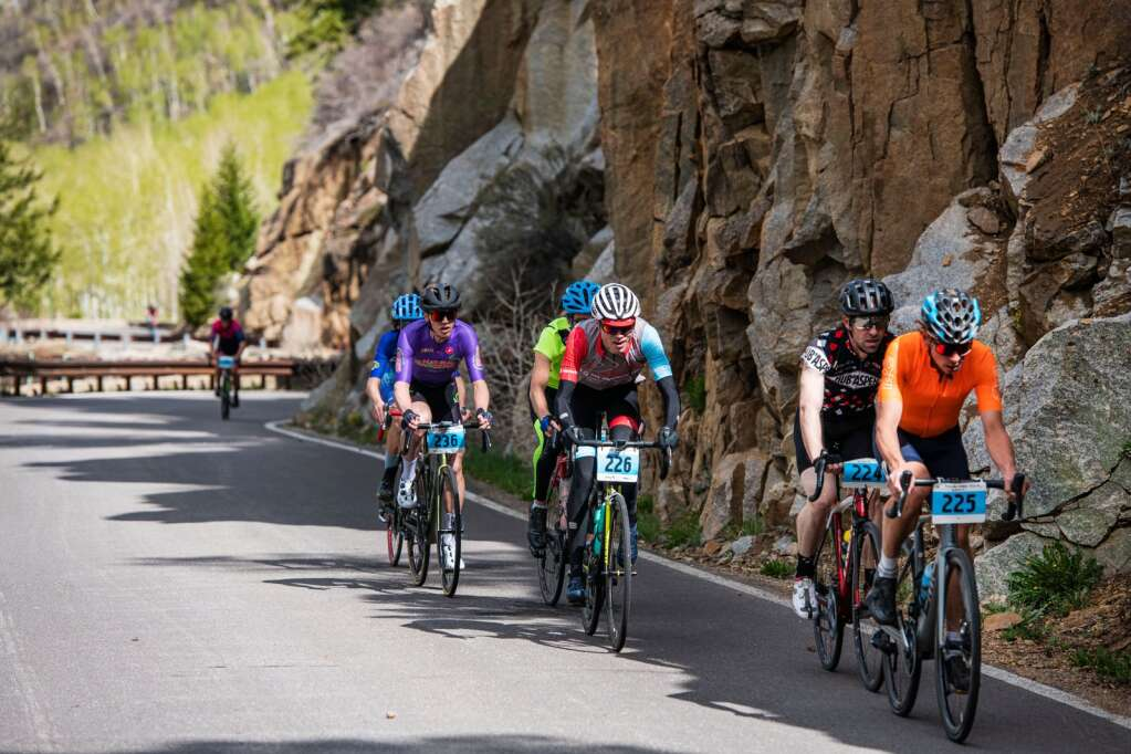 The first competitors lead the pack up Independence Pass near the two-mile mark during the 2021 annual Ride for the Pass event starting in Aspen on Saturday, May 22, 2021. (Kelsey Brunner/The Aspen Times)