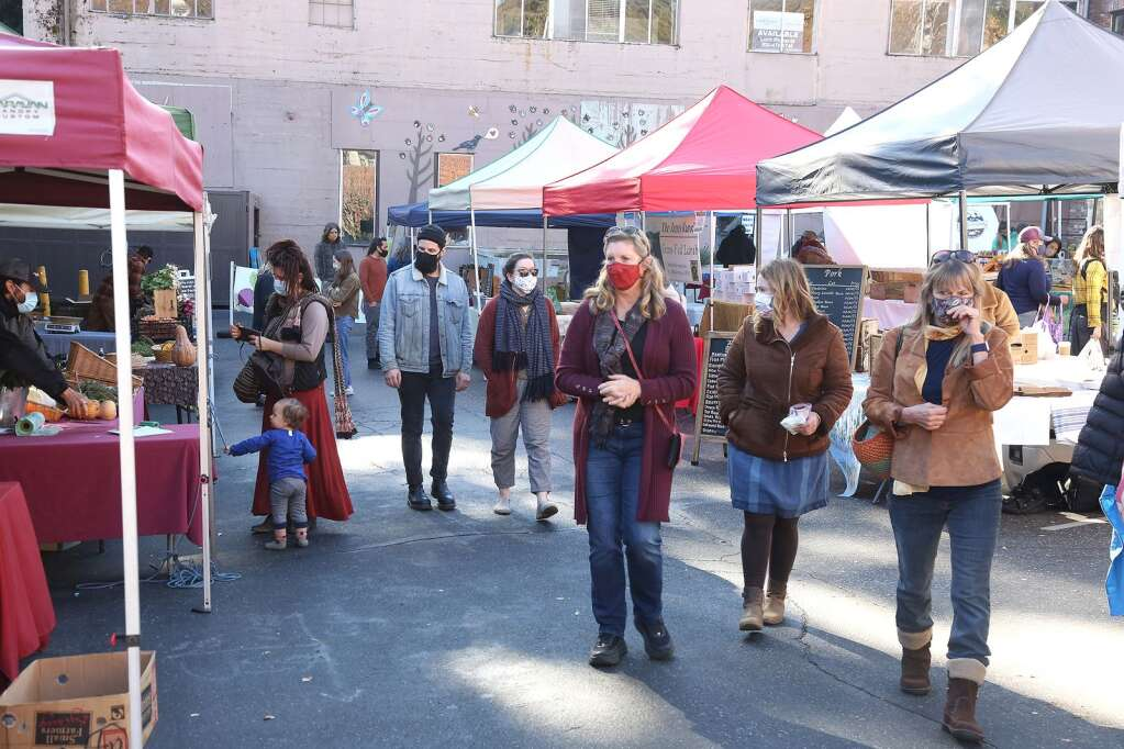 Folks peruse through the many different vendor booths during Saturday's first Winter Market of the cold weather farmers market season Dec. 6. | Photo: Elias Funez