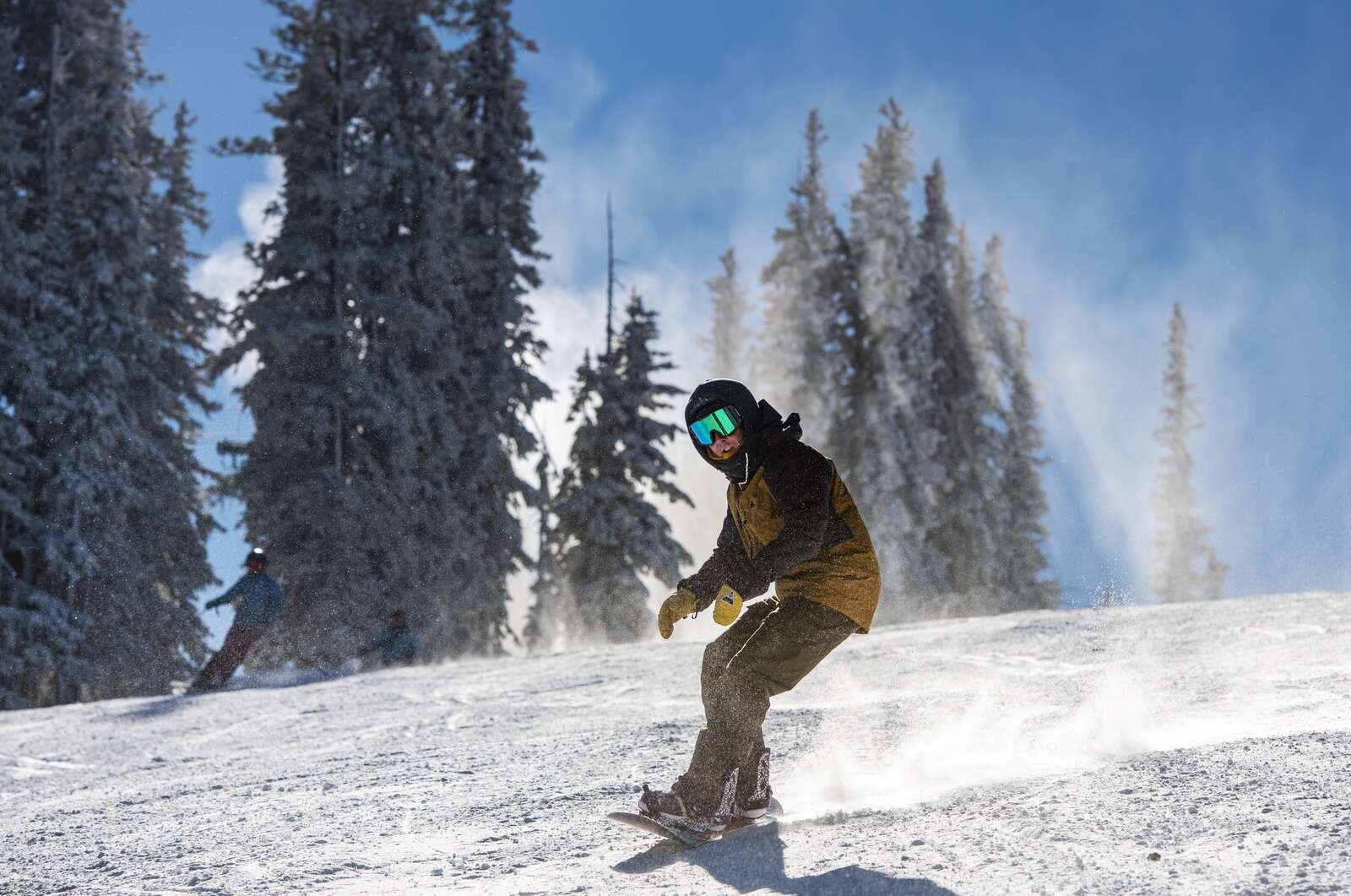 A snowboarder carves on opening day on Aspen Mountain on Wednesday, Nov. 25, 2020. (Kelsey Brunner/The Aspen Times)