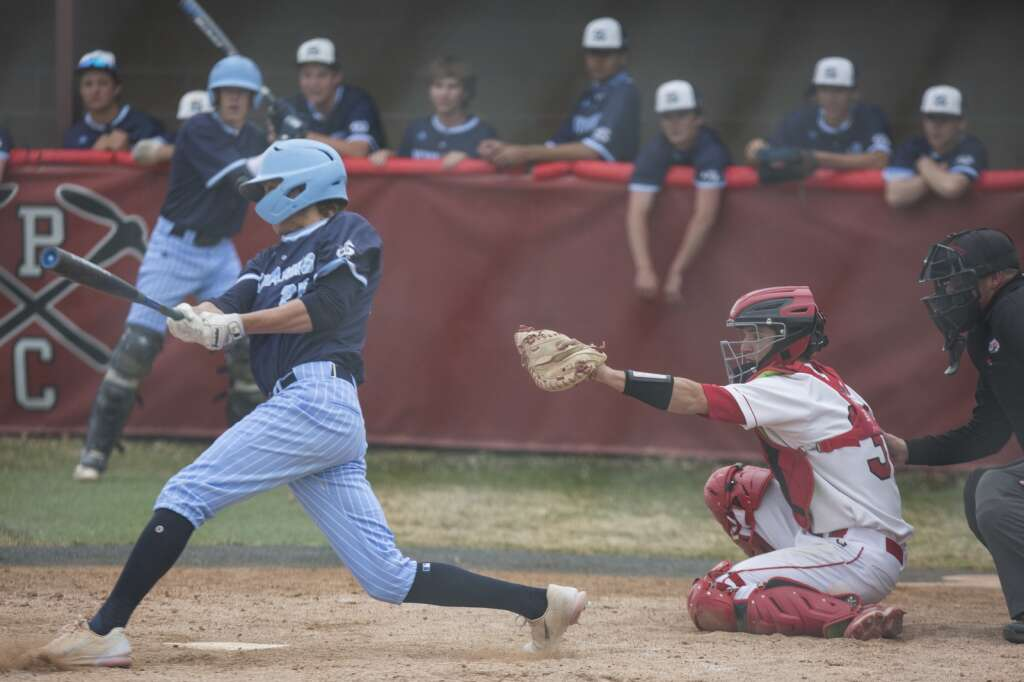 Park City's catcher Ryan Hunt (31) catches the ball at home plate. Salem Hills swings and misses while at bat for the Skyhawks during their matchup Monday afternoon, April 5, 2021. (Tanzi Propst/Park Record)