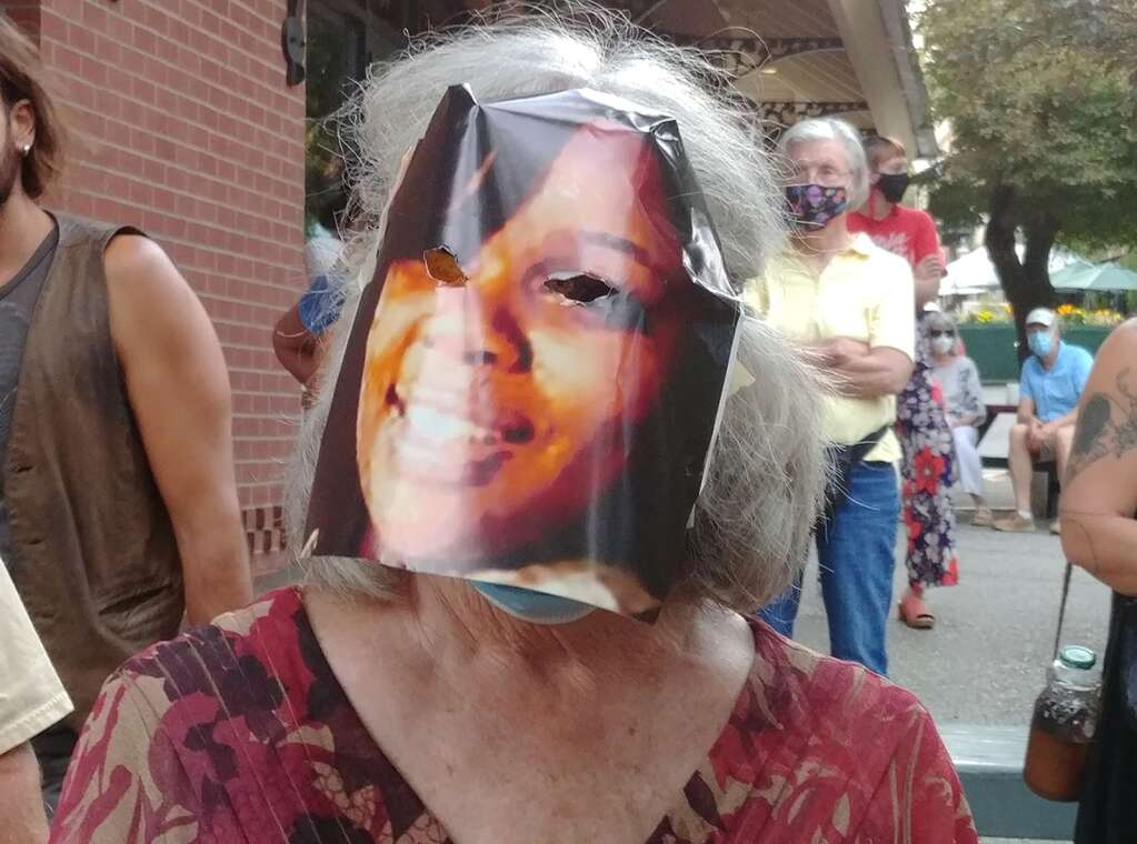 An attendee of the Black lives lost vigil wears a mask depicting Breonna Taylor, who was killed by police in Louisville Kentucky March 13.