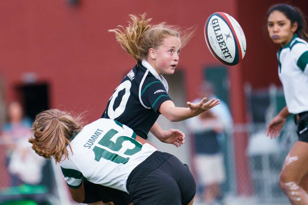 Summit sophomore Viola Koning pitches the ball on the Green team during the rugby scrimmage match held at Tiger Stadium on Thursday, Sept. 2. | John Hanson/For the Summit Daily News