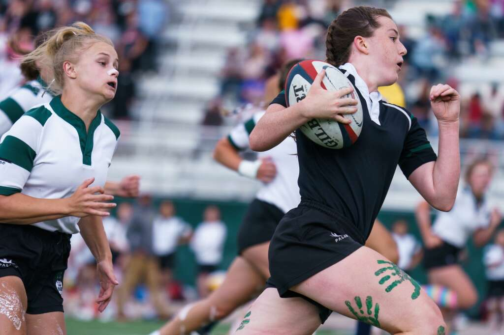 Sophomore Regan Jackson outruns junior Morgan Fields during the Green-White rugby scrimmage held at Tiger Stadium on Thursday, Sept. 2. | John Hanson/For the Summit Daily News