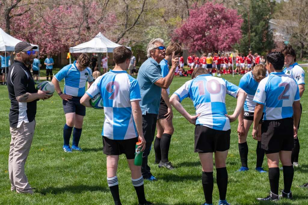 Head coach Lance French, center, directs the Summit High School boys rugby team at Cook Park in Denver on Saturday, May 8.   Photo by Stefan de Vogel