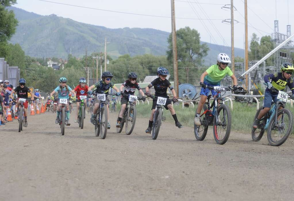 The kids 9-10 race takes off from the start at the Town Challenge Emerald Endurance race on Wednesday evening. (Photo by Shelby Reardon)