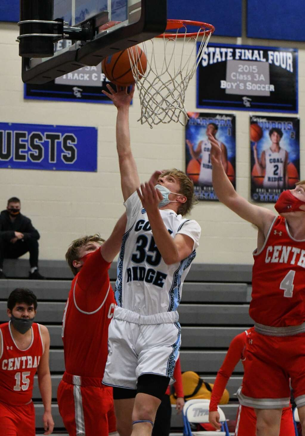 Coal Ridge Titan Kevin DiMarco jumps for the layup through the defending Grand Junction Central Warriors during Thursday night's game.  |Chelsea Self / Post Independent