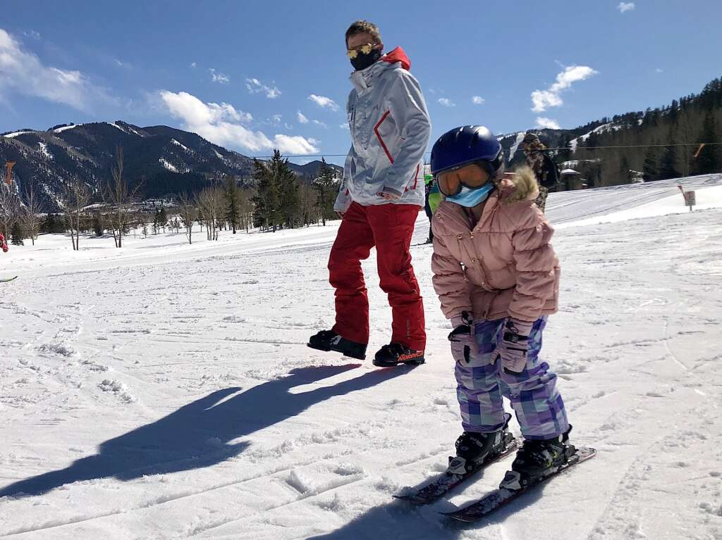 Instructor Nicholas Nagey follows Glenwood Springs Elementary School third-grader Marbely Castro Ramirez down the hill during a School Ski Day program at Buttermilk on March 12, 2021.   Kaya Williams/The Aspen Times