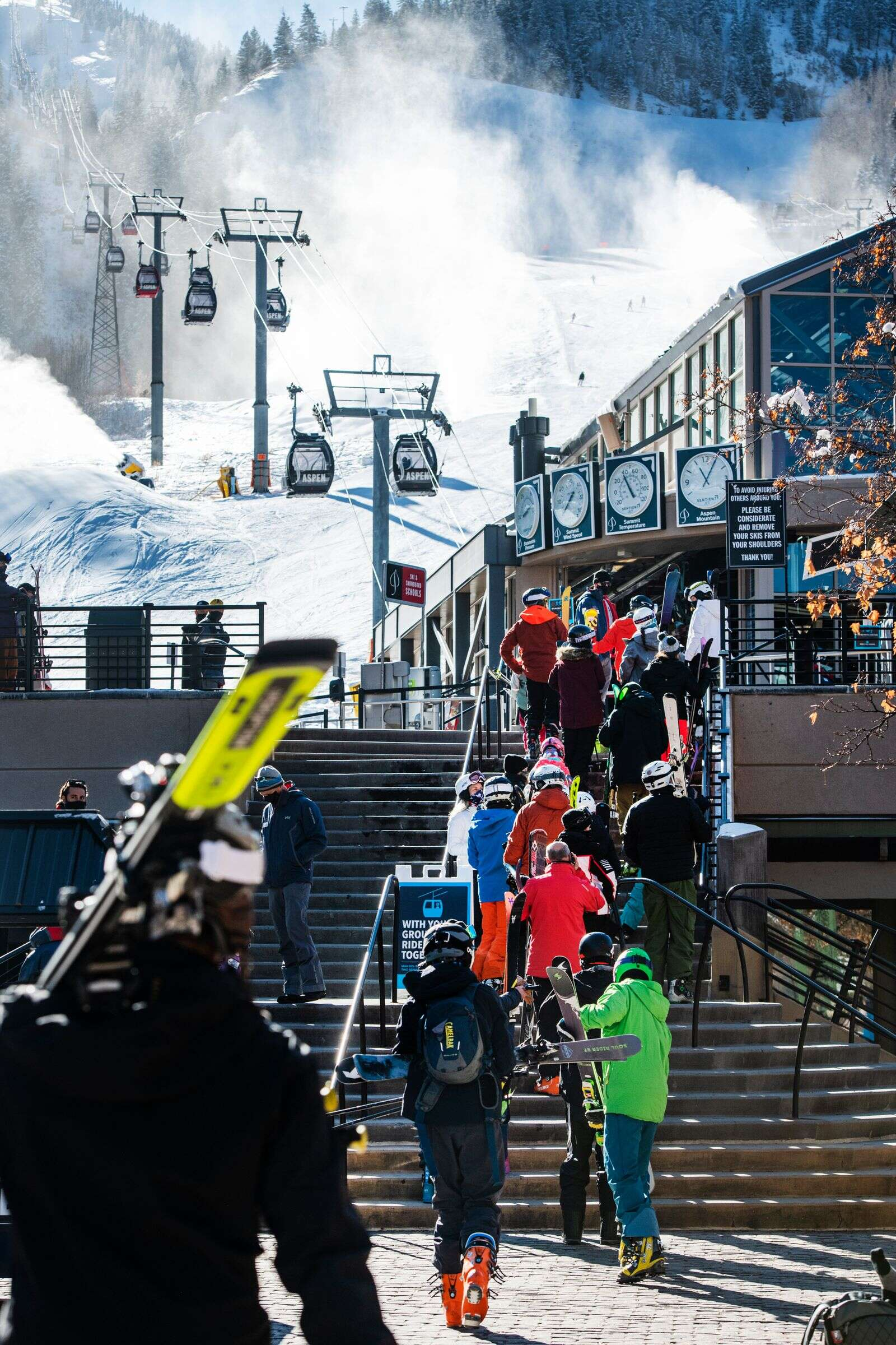 A line of skiers extend into Gondola Plaza as they wait to load onto the Silver Queen Gondola on Aspen Mountain on Friday, Nov. 27, 2020.