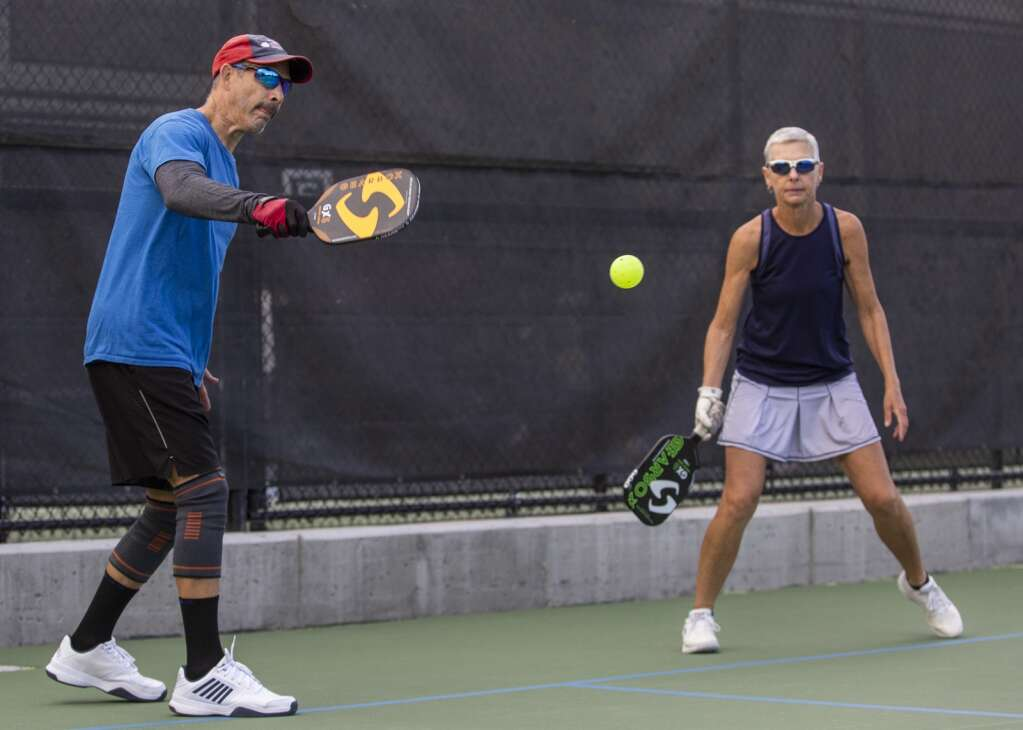 Frank Matamoros returns a volley during a pickleball matchup at the PC MARC during the club's marathon event Saturday morning, Sept. 11, 2021. (Tanzi Propst/Park Record)