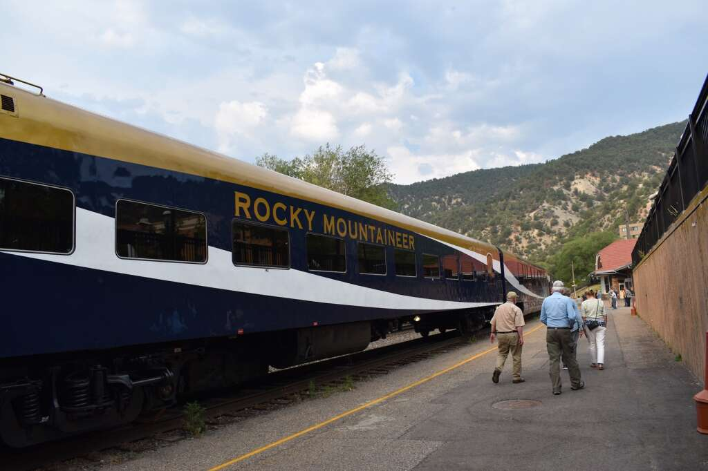 The Rocky Mountaineer sits at the station in downtown Glenwood Springs after its inaugural arrival on Sunday, Aug. 15, 2021.