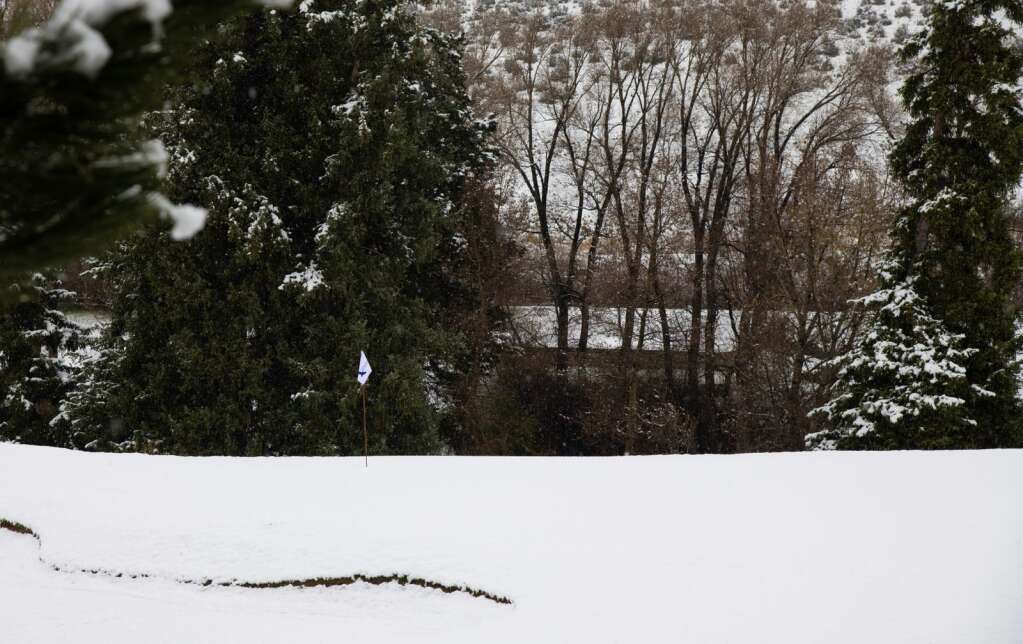 An EagleVail Golf Club green is covered in snow Monday morning.   Mort Mullikan / Special to the Daily