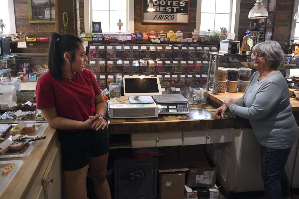 Autumn Kennedy, a senior at Snowy Peaks High School, talks with Becky Foote, manager of Foote's Rest Sweet Shoppe in Frisco, on Tuesday, Aug. 17. | Photo by Jason Connolly / Jason Connolly Photography