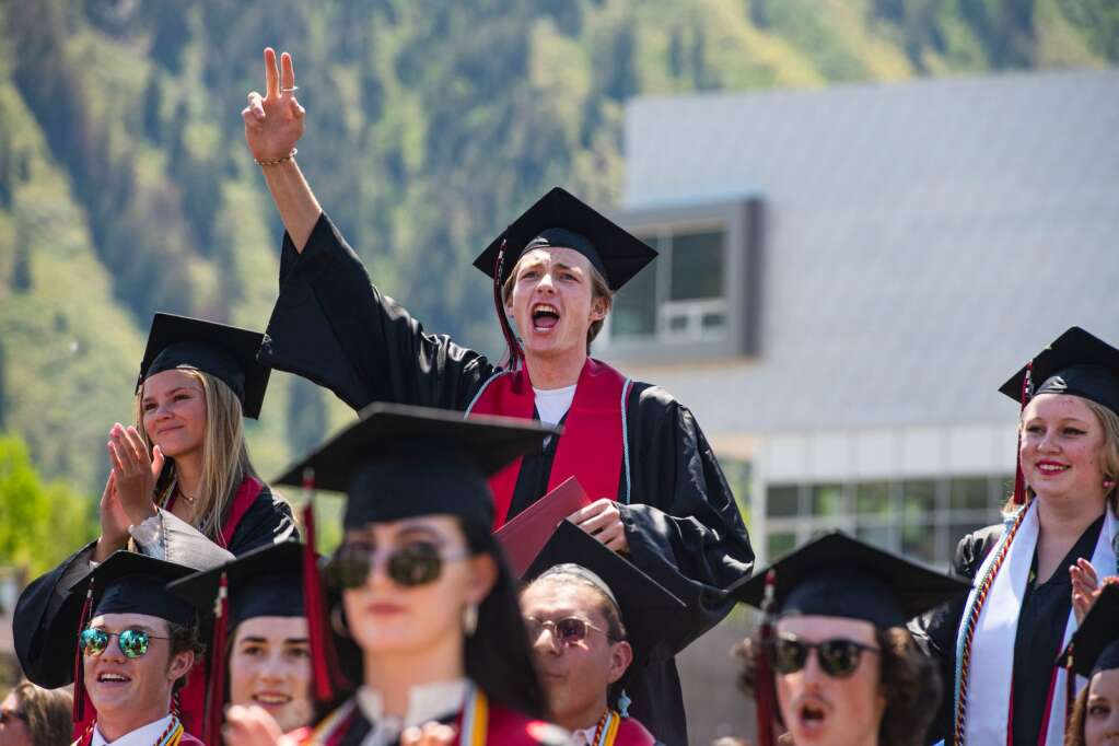 Aspen High School graduates cheer for their classmates during the commencement ceremony on the football field on Saturday, June 5, 2021. (Kelsey Brunner/The Aspen Times)