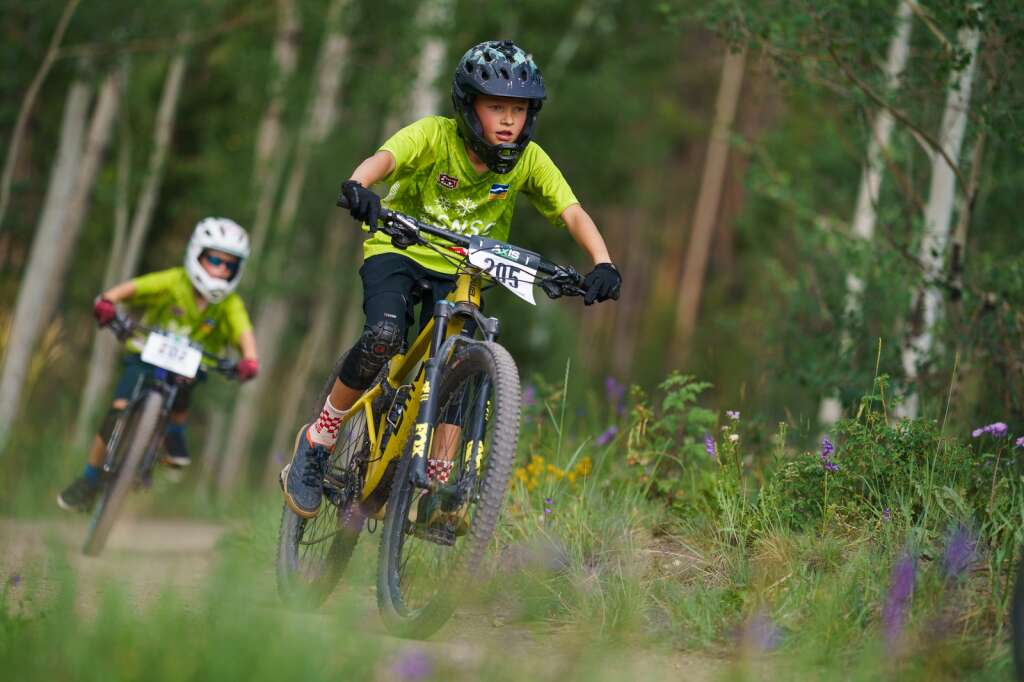 Olin Zygulski pedals towards a fifth place finish in the junior boys 11-12 division at Wednesday's Soda Creek Scramble mountain bike race in Keystone.   Photo by John Hanson