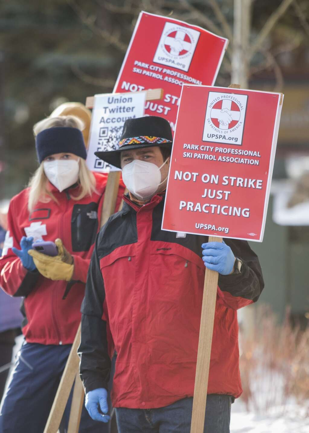 'Not on strike just practicing.' Ski patrollers, locked in negotiations with Vail Resorts, picket at PCMR.