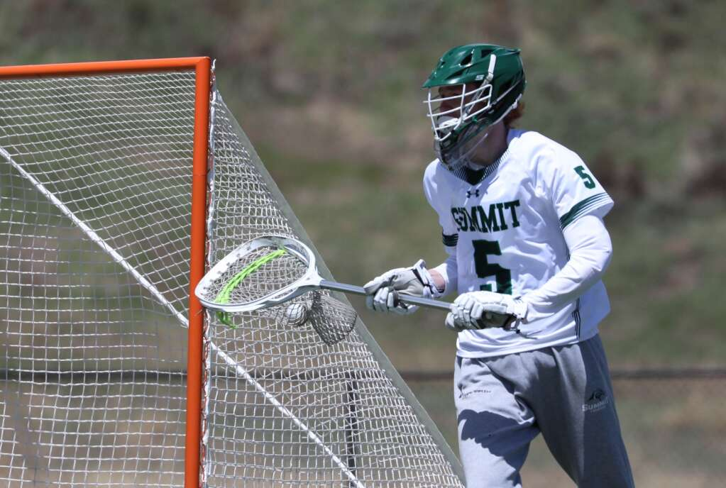Summit High boys lacrosse junior goalie Jac Crowe cradles the ball during Summit's 11-8 loss to Battle Mountain in Breckenridge on Saturday, May, 22. | Photo by Ashley Low / Ashley Low Photography