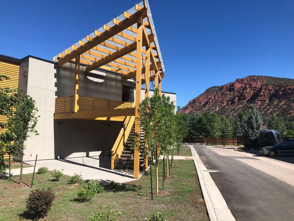 The Red Hill Lofts affordable housing project in Carbondale opens this month. The namesake geologic feature is in the background. | Scott Condon/The Aspen Times