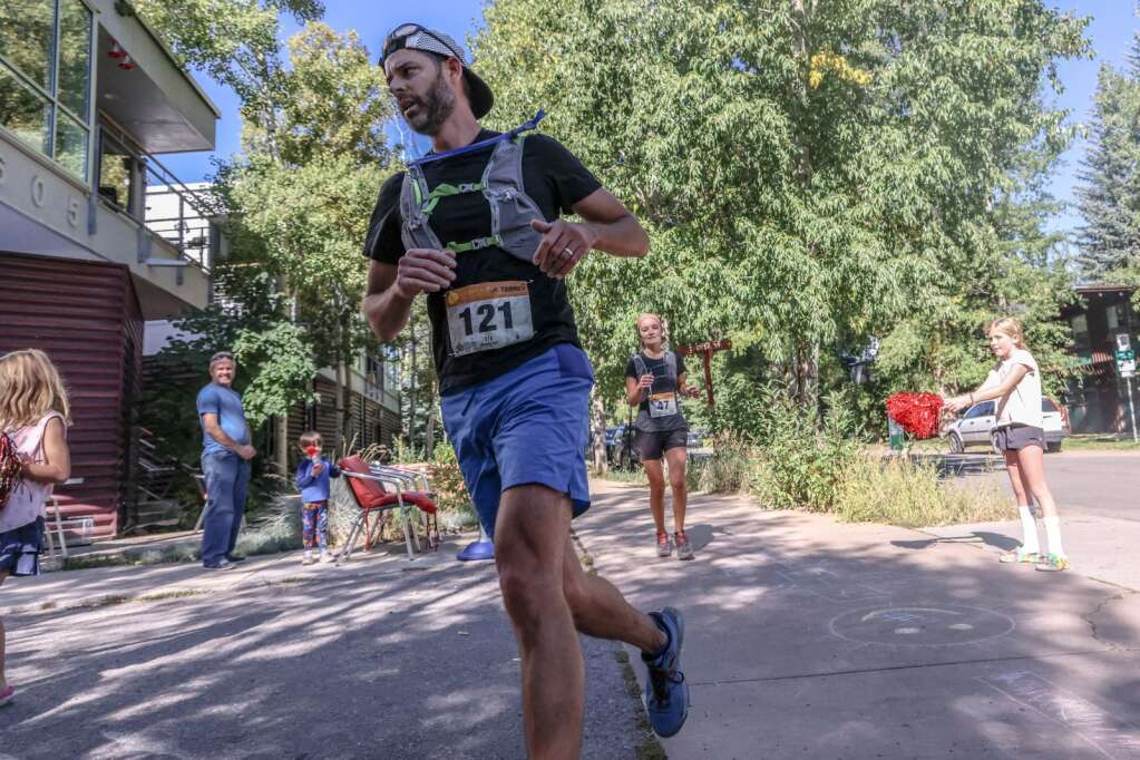 Boulder's Josh Nothwang, front, and Basalt's Amanda Farone compete in the Golden Leaf half marathon on Saturday, Sept. 18, 2021, in Aspen. Photo by Austin Colbert/The Aspen Times.
